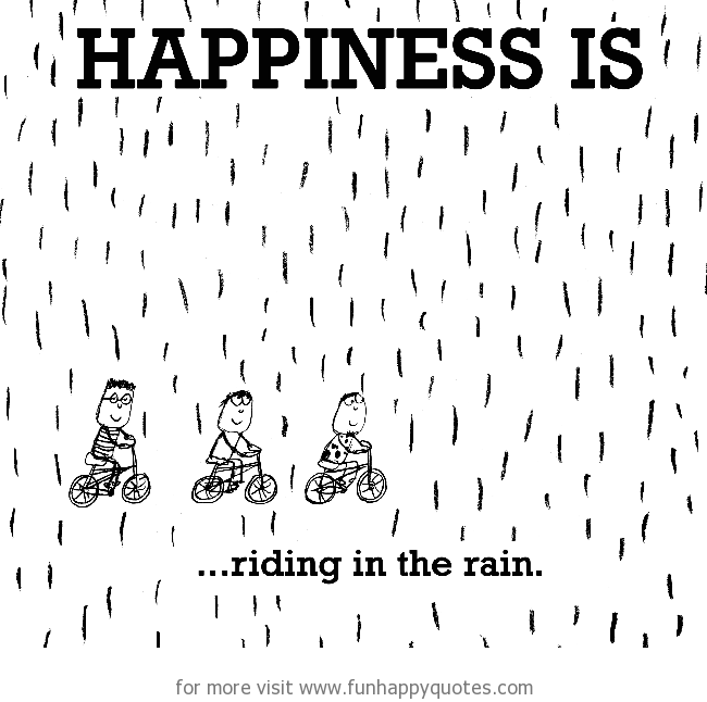 Happiness is, riding in the rain.