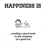 Happiness is, reading a good book in the company of a good cat.